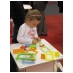Girl taking a big puzzle challenge with the Profi Cubes at the Frankfurt Buchmesse 2010.